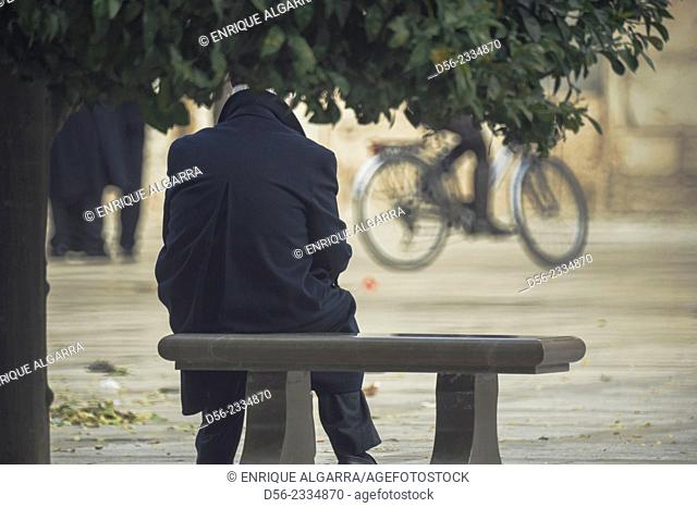 man seated on a bench, Valencia, Spain