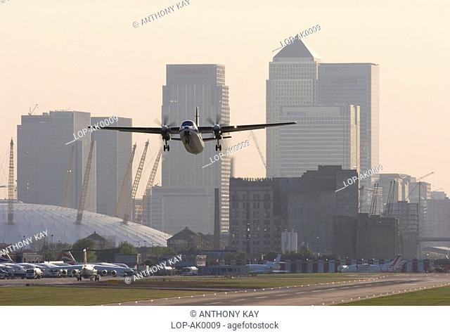 England, London, Newham, Plane taking off from London City Airport in Newham