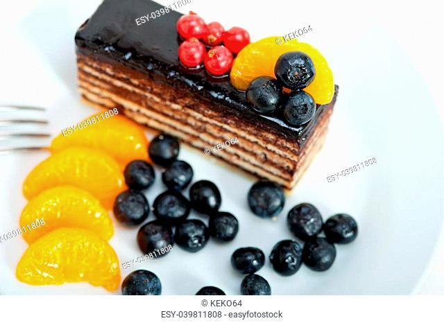 chocolate cake and fresh fruit on top closeup macro
