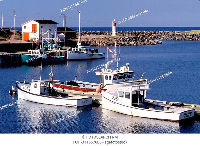Cape Breton, Nova Scotia, NS, Canada, Fishing boats docked in harbor on Pleasant Bay on the Gulf of St. Lawrence in Cape Breton