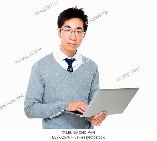Asian businessman use of laptop computer