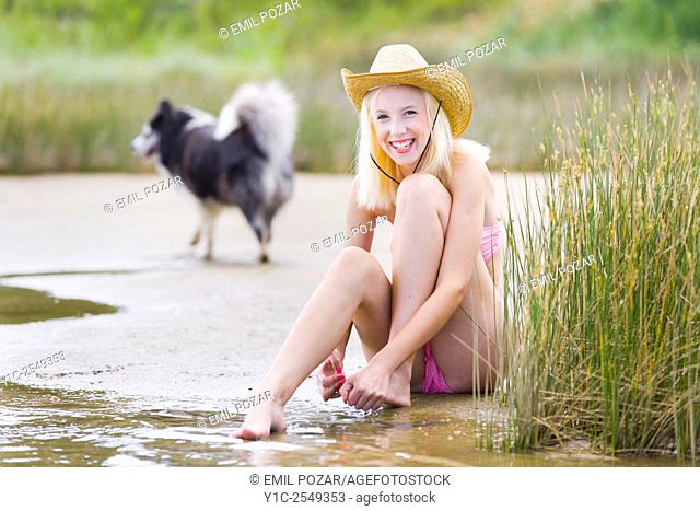 Teen girl and dog passing by