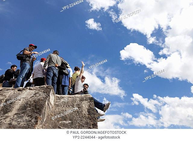 Group of young tourists gathered on el Tepozteco Pyramid - Tepoztlán, Morelos, Mexico