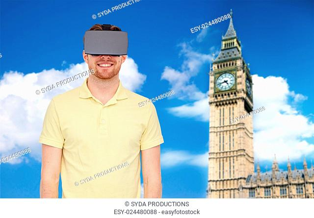 3d technology, virtual reality, travel, entertainment and people concept - happy young man with virtual reality headset or 3d glasses over london big ben tower...