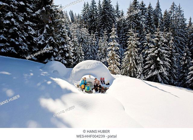 Austria, Salzburg County, Family sitting near igloo