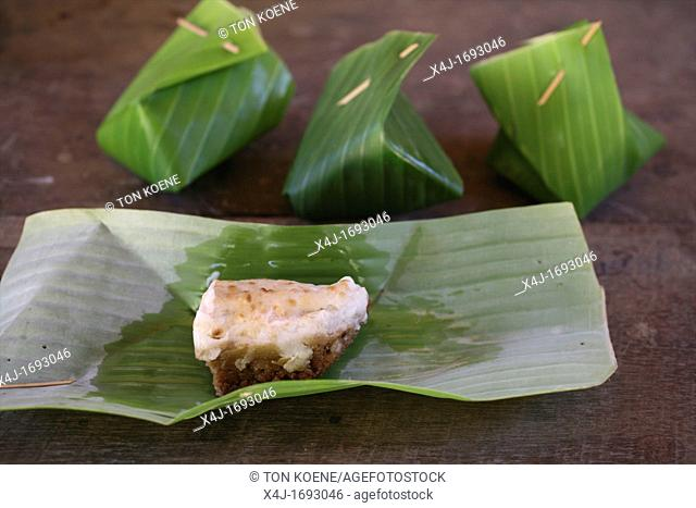 Closeup of food wrapped in banana leaves Approximately 300 Burmese refugees in Thailand are members of the indigenous group known as the Longnecks The largest...