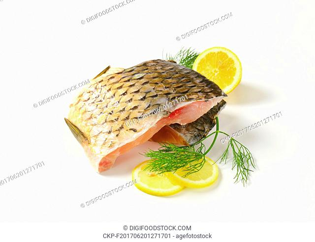 Raw carp fillets with lemon and dill