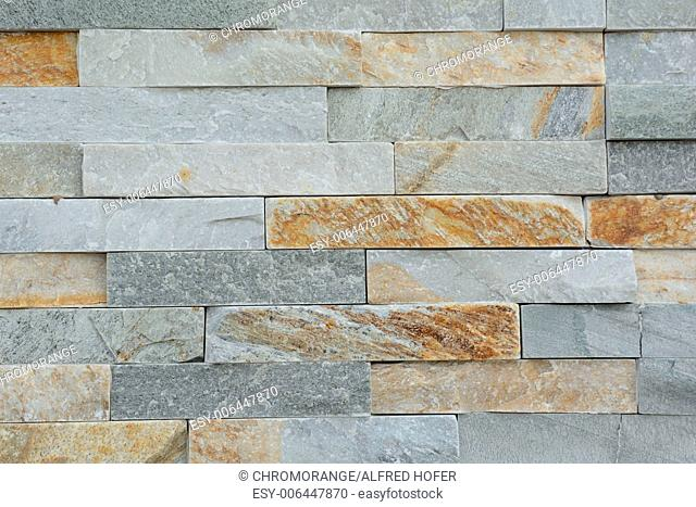 smooth natural stones form a stone wall