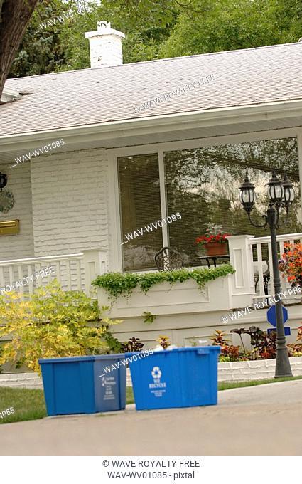 Blue recycling bins in front of house, Regina, Saskatchewan