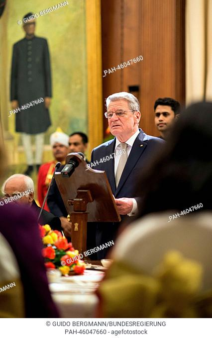 German President Joachim Gauck (C) makes a speech during the State Dinner at the official residence of the Indian President in New Dehli, India