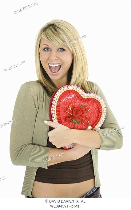 Young Caucasian woman very excited after recieving a special gift