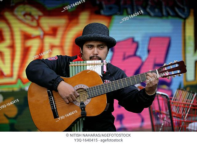 Portrait of a hispanic musician on mission street in San Francisco, California  Mission district is one of the most colorful neighborhoods in San Frncisco...