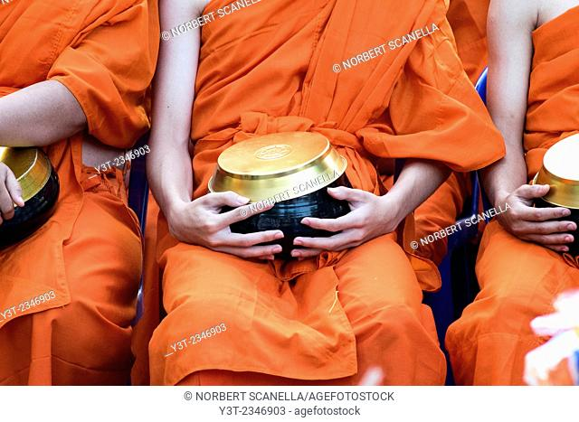 Asia. Thailand, Chiang Mai. Monks. Offering bowl