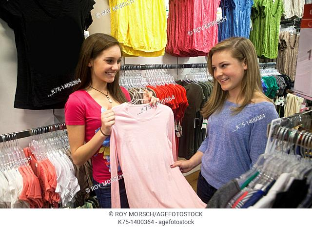 Teens deciding on purchase