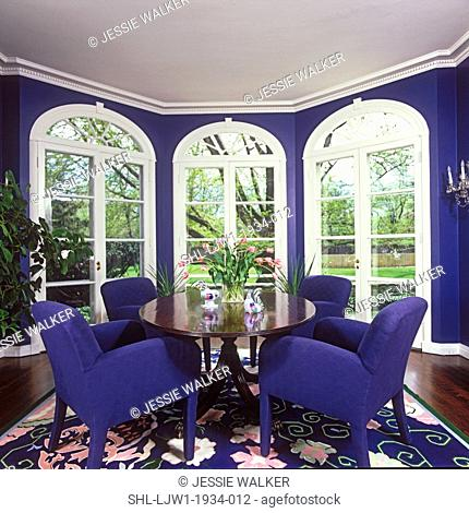 EATING AREAS: With a view, three french doors open to lovely garden, arched Palladian transoms over french doors, white molding, architectural trim used