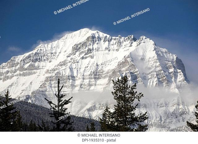 snow-covered mount temple, lake louise, alberta, canada