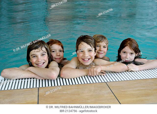 Children and teenagers in a swimming pool