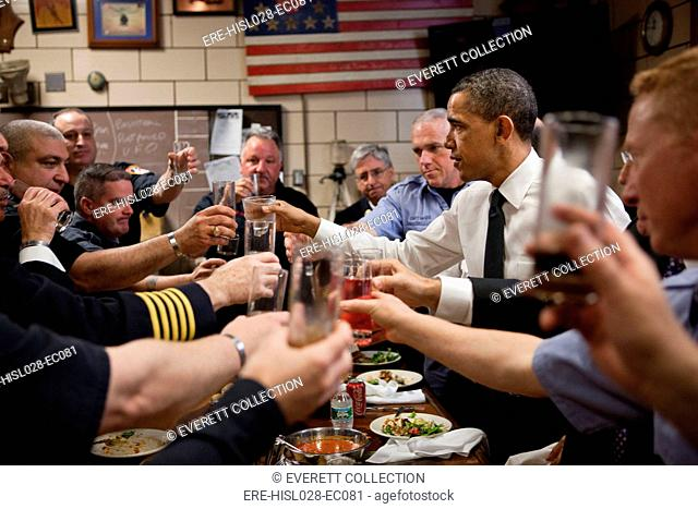 President Barack Obama and firefighters toast during a lunch at Engine 54 Ladder 4 Battalion 9 Firehouse in New York N.Y. May 5 2011