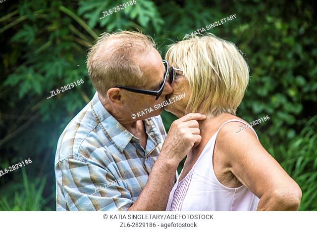 Older mature retired caucaisna couple talking and kissing