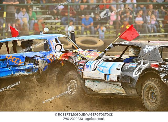 Two cars smash into each other at a demolition derby event in rural Alberta Canada