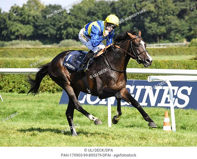 The jockey Filip Minarik wins the 145th Grand Prize of Baden with his horse Guignol on the 6th racing day in Iffezheim, Germany, 3 September 2017