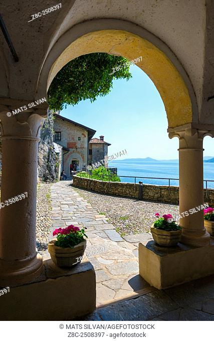 Arch in Eremo di Santa Caterina del Sasso and lake Maggiore in a sunny day in Lombardy, Italy