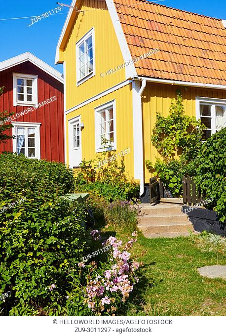 Red and yellow painted timber houses, Sweden, Scandinavia