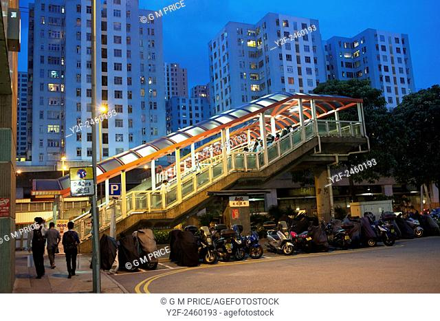 pedestrian footbridge and residential apartments at Kowloon Bay, China