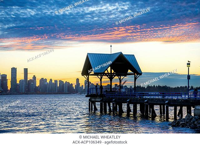 Vancouver skyline and pier at Waterfont Park, N. Vancouver, British Columbia, Canada