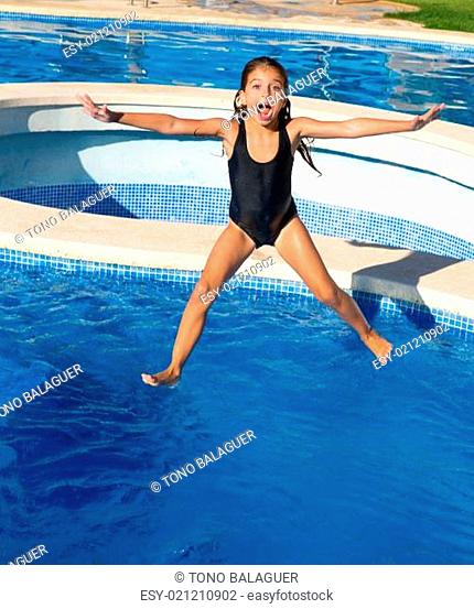 children girl jumping to the blue pool black swimsuit