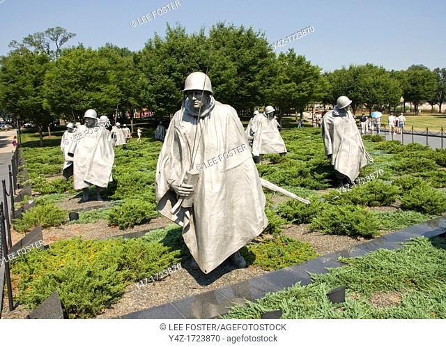 Washington DC, USA, the Korean War Veterans Memorial. Soldiers in a platoon march warily across a field