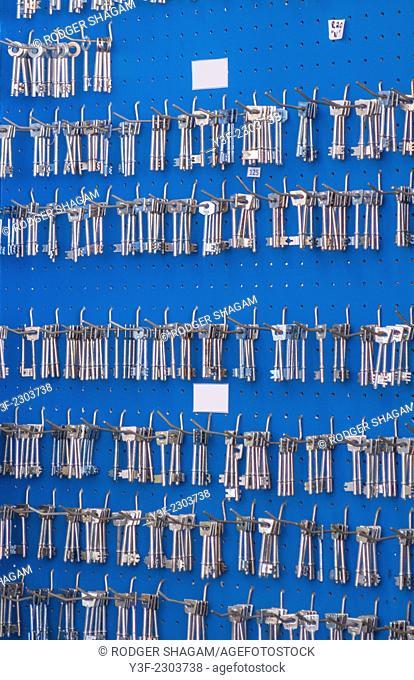 A wall of blank,uncut keys on display in a locksmith's shop