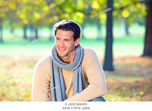 Mid adult man in autumn forest