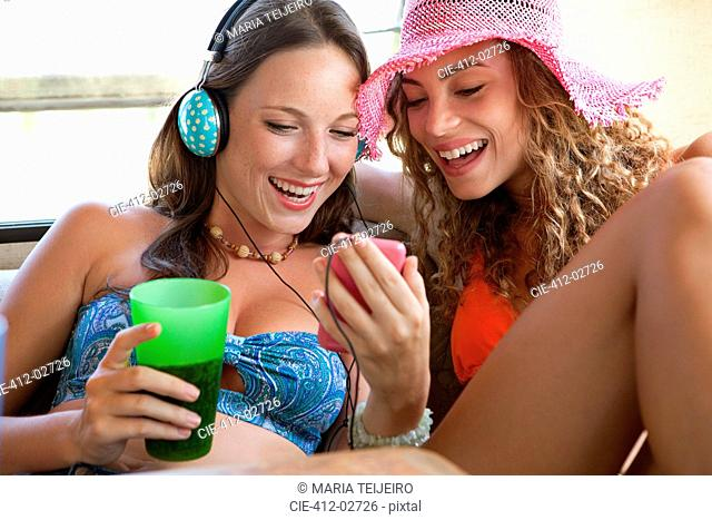 Women using mp3 player together