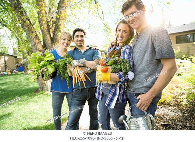 Portrait of holding carrying freshly harvested vegetables