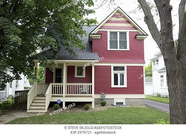 Lovely rehabbed house with porch and artistic red paint job. St Paul Minnesota MN USA
