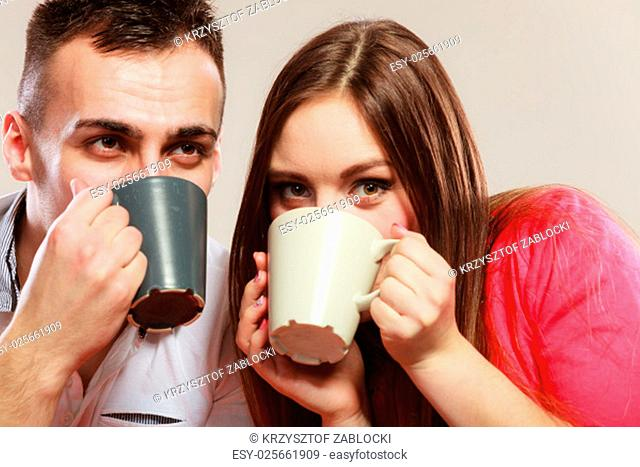 happiness and healthy relationship concept. attractive couple drinking tea or coffee together,man and woman holding mugs with hot beverage