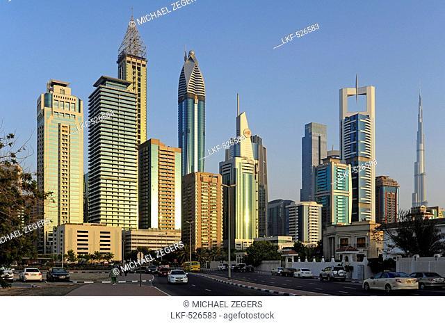 Road in the Al Satwa quarter, behind it skyscrapers on Sheikh Zayed Road, Dubai, United Arab Emirates