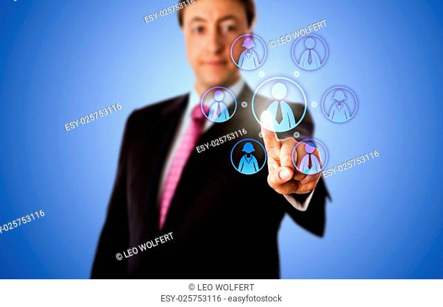 Smiling business consultant is contacting a virtual work team by touch. The team has a male team leader and three female and male knowledge workers