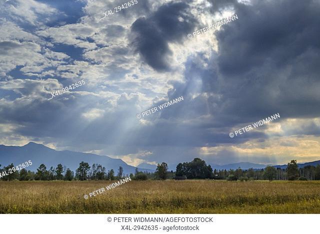 Sunbeams breaking through clouds, Bavaria, Germany, Europe