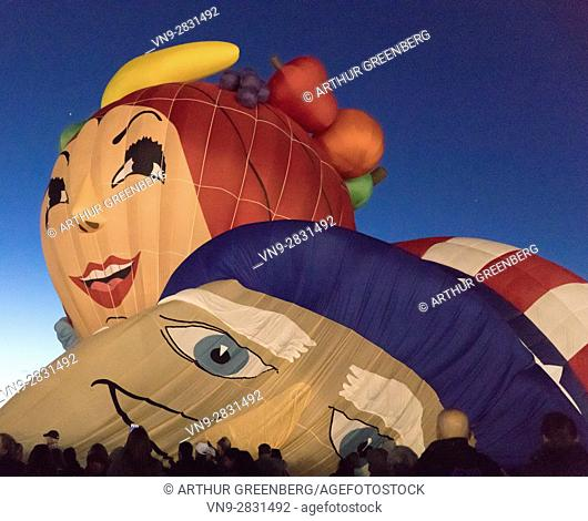 Albuquerque, NM, USA - 7 October 2016: Visitors watch themed Balloons inflate at sunset Special Shape Rodeo, Albuquerque International Balloon Fiesta