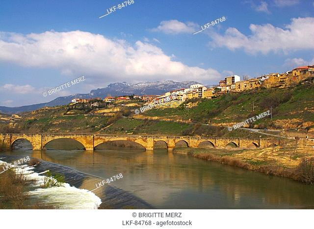 Medieval stone bridge over river, Rio Ebro, in Spring, San Vicente de la Sonsierra, La Rioja, Spain
