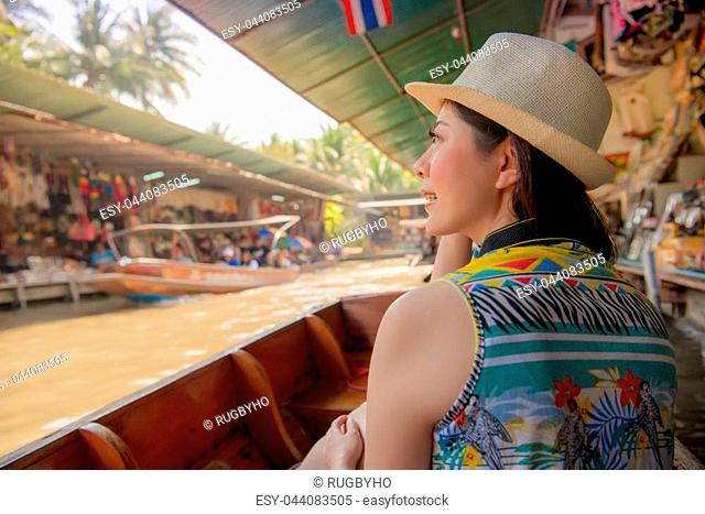 Damnoen Saduak floating market of Thailand. Tourist on Asia travel looking at Thai landscape sitting on famous tourist destination and attraction