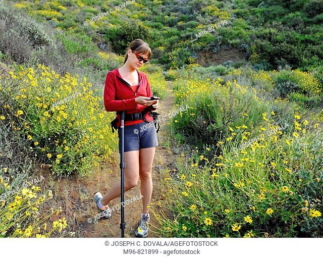 Female hiker with cell phone, Thousand Oaks, California, USA