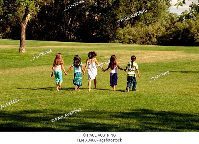 Group of Children Walking in Park