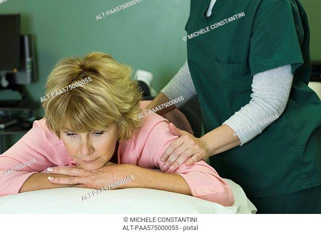 Woman enjoying massage by physical therapist