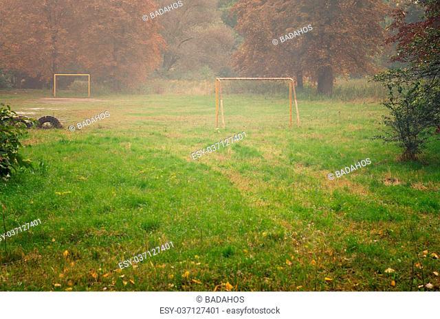Rural football field in the fog