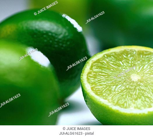 Close-up of limes, one cut in half