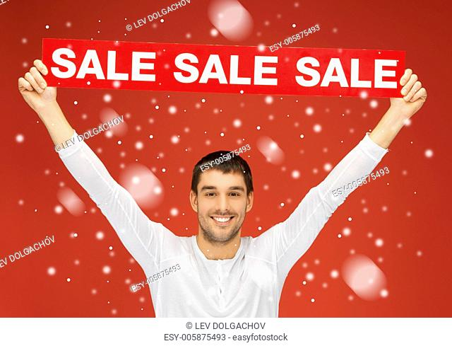bright picture of handsome man with sale sign