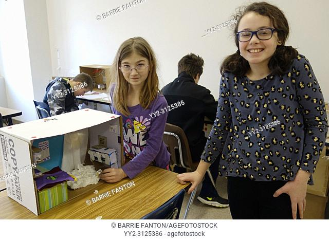 6th Grade Girls Working on Model Shelter for Science Project, Wellsville, New York, USA